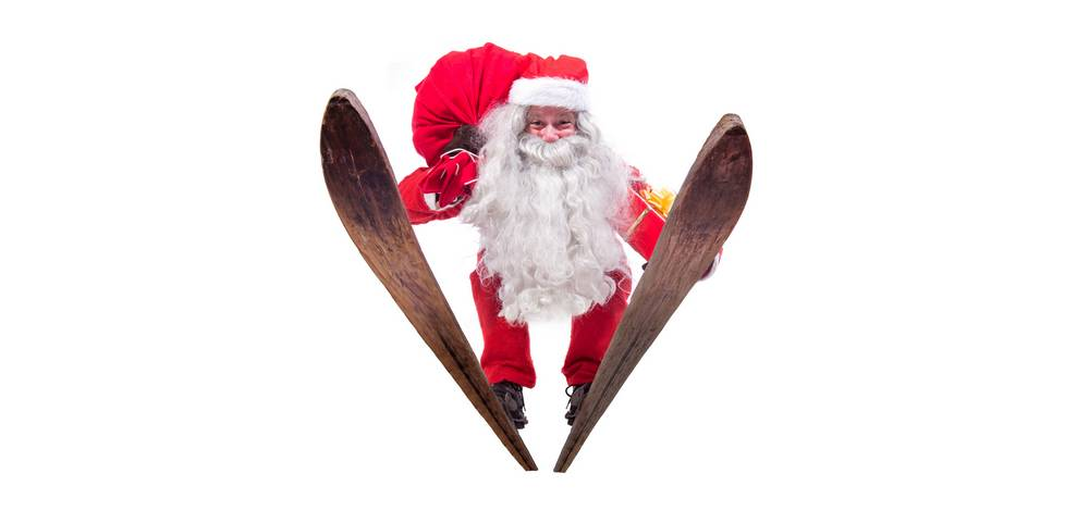 Santa Claus jumps on skis isolated on white background